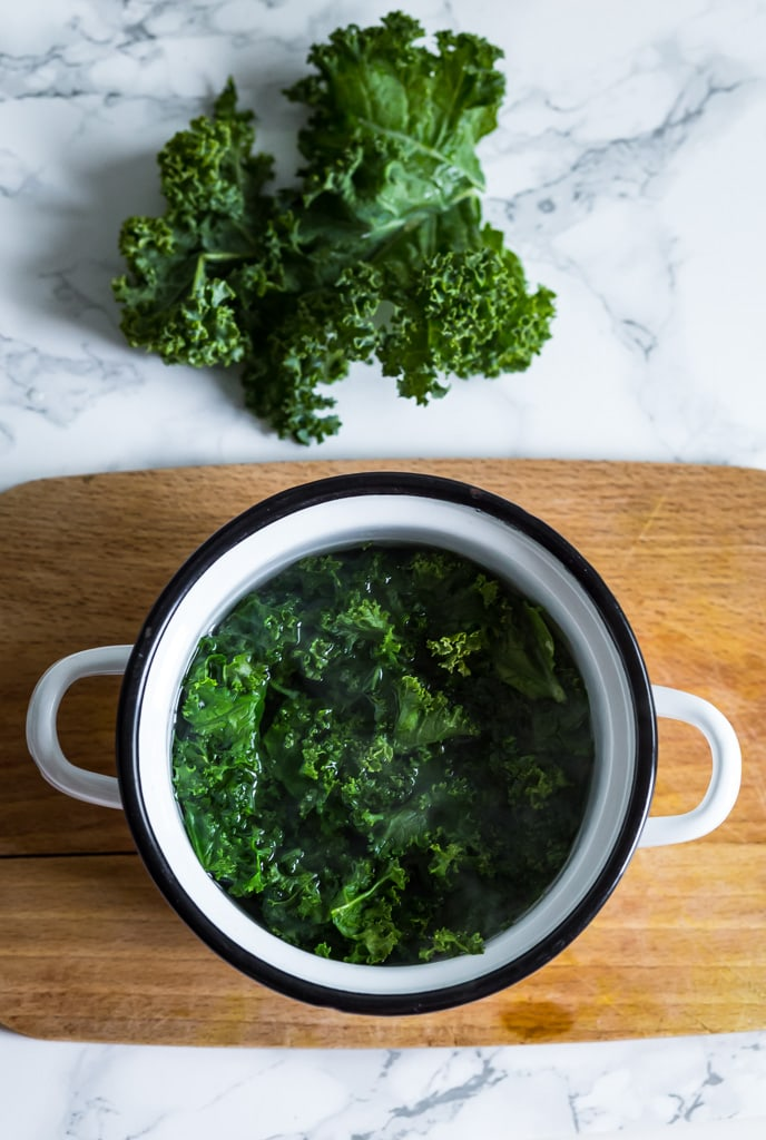 kale in a pot for blanching
