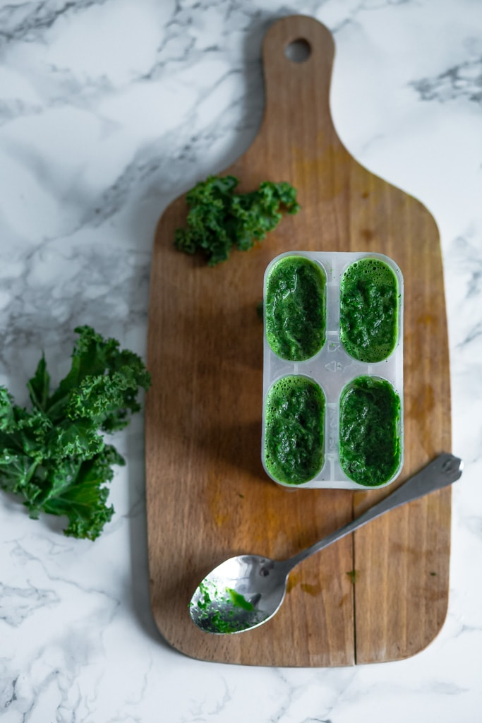 pureed kale in ice cream molds for freezing