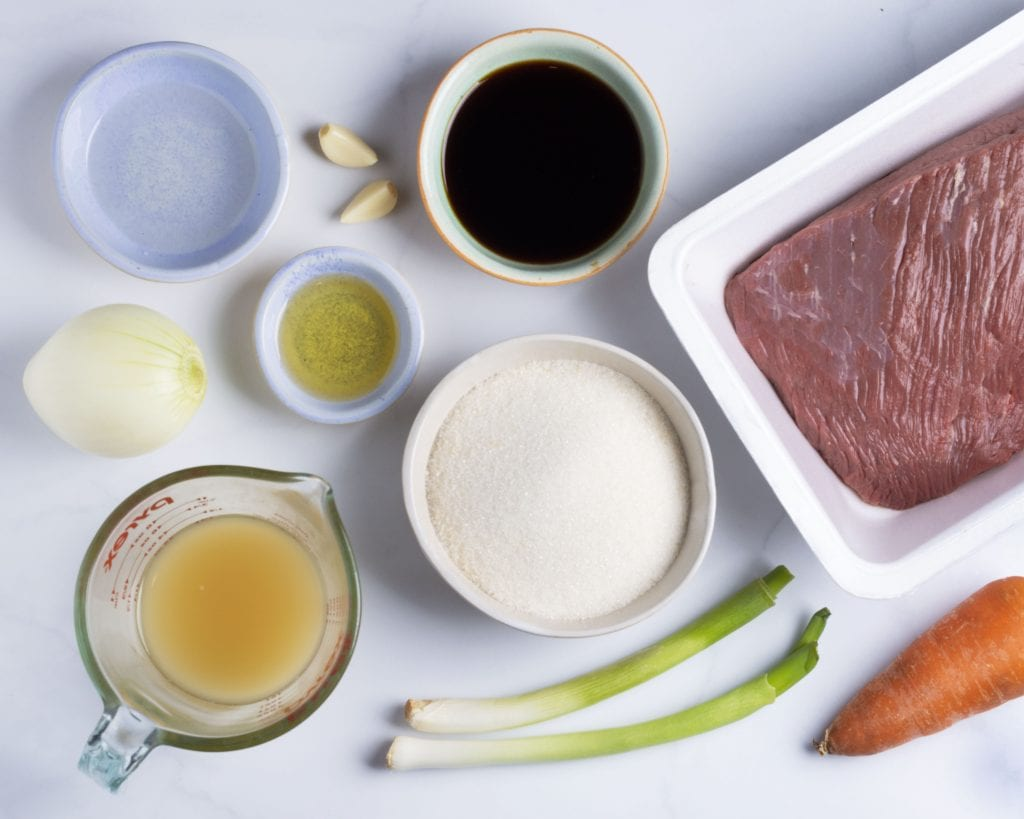 Ingredients for sous vide flank steak and teriyaki marinade soy sauce, apple juice, sugar, scallions and garlic