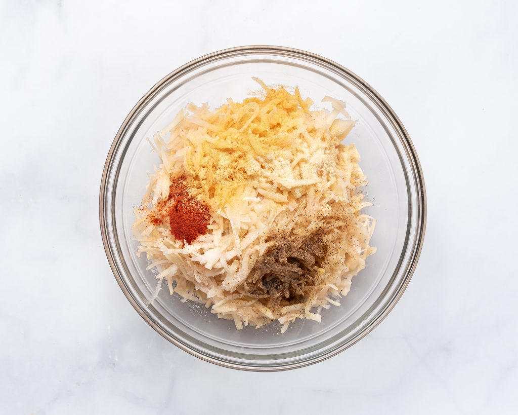 ingredients for hash browns in a bowl