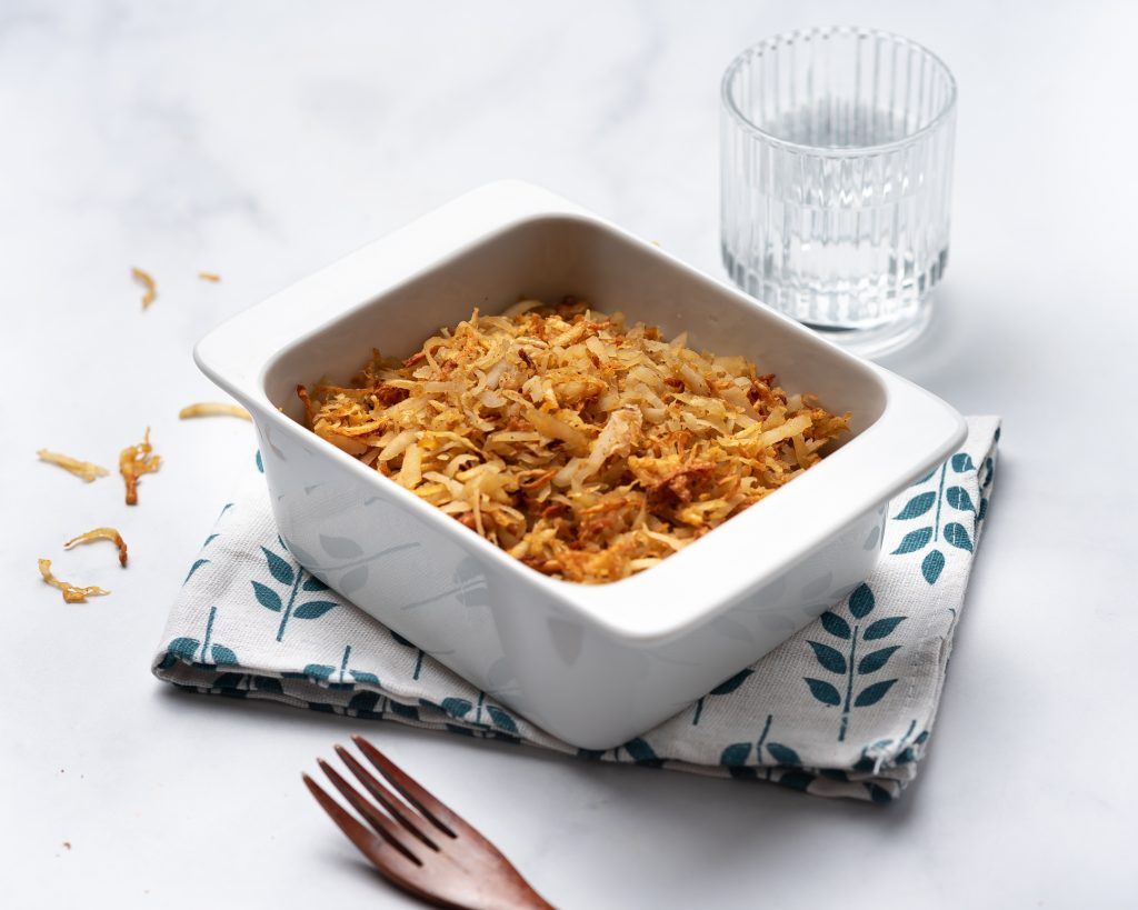 baking dish with crispy hash browns