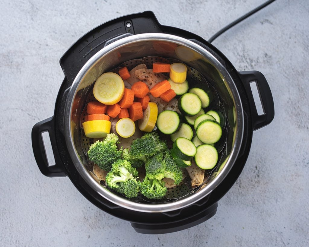 instant pot filled with fresh chopped vegetables